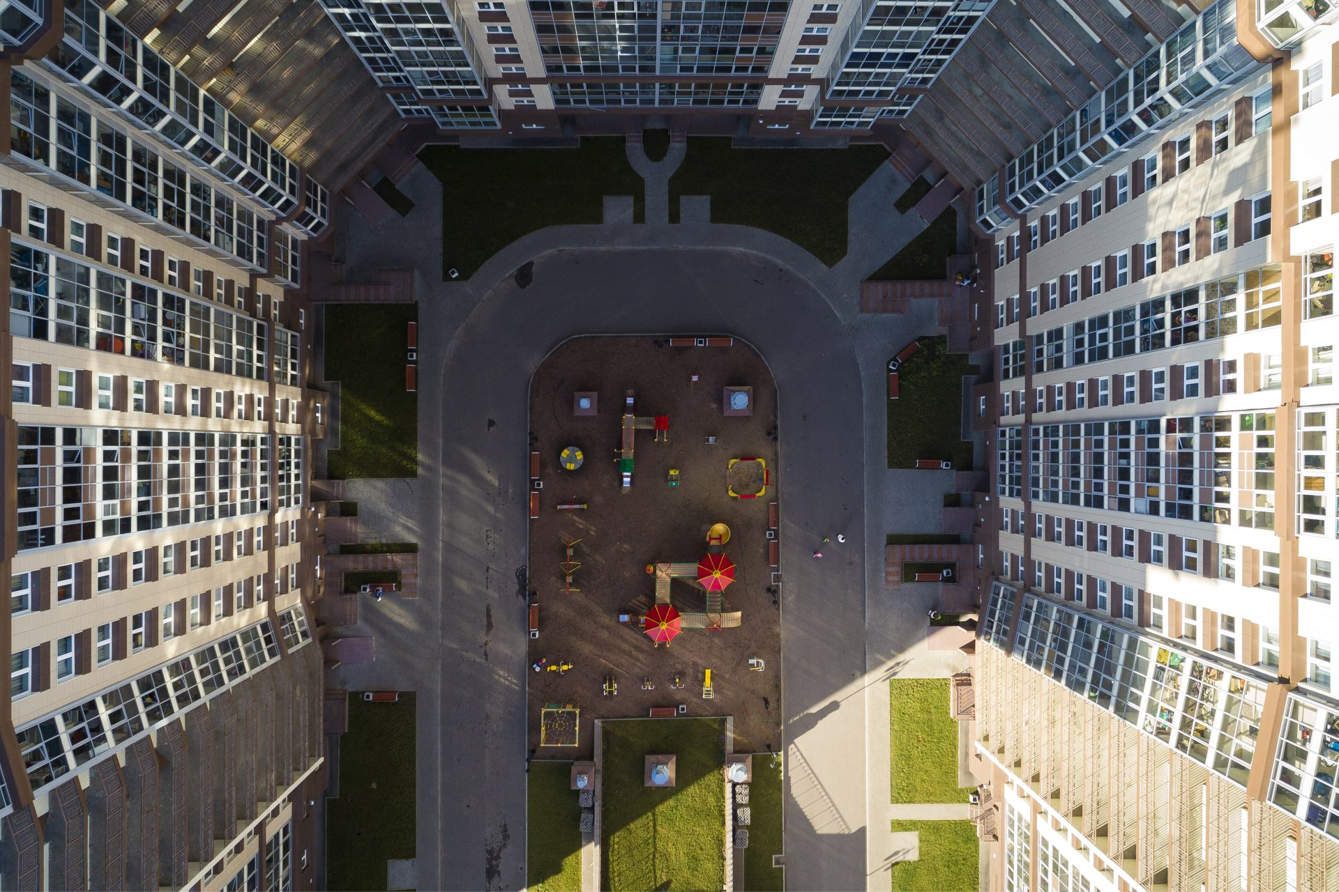 Bird-eye view of the playground kids in a residential complex in sunny day