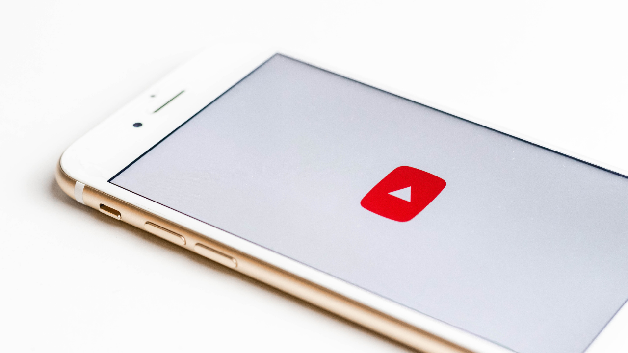 Phone with YouTube on a white background